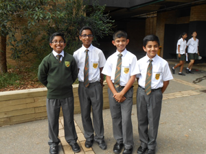boys representing summer and winter school uniform