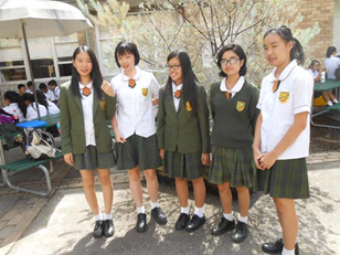 senior girls representing summer and winter school uniform