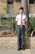 a senior boy wearing school uniform